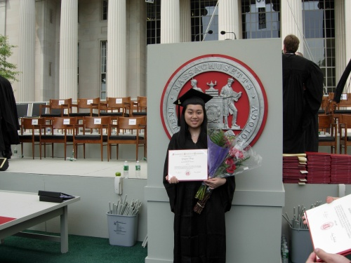 With my diploma in front of MIT's seal