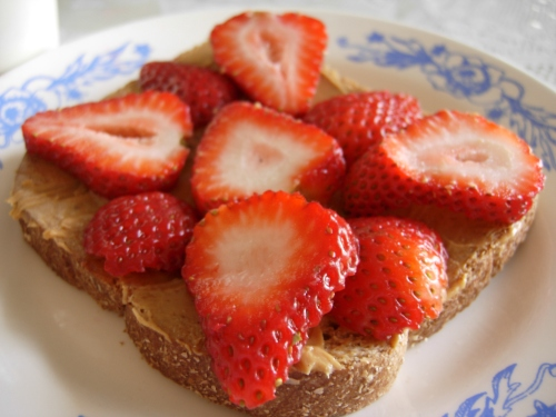Whole grain toast with peanut butter and strawberries