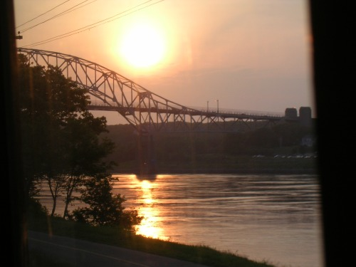 The sun setting over the river