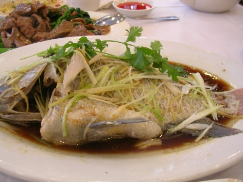 Steamed fresh whole fish with soy ginger sauce