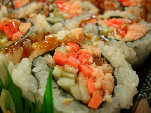 Grilled salmon sushi with cucumbers and carrots