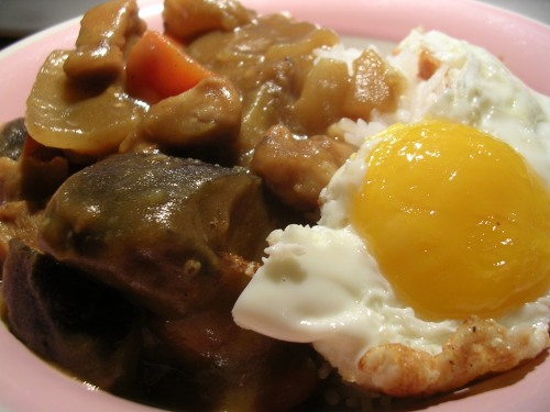 Japanese curry with fried egg over rice