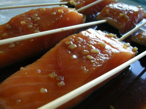 Salmon skewers marinating