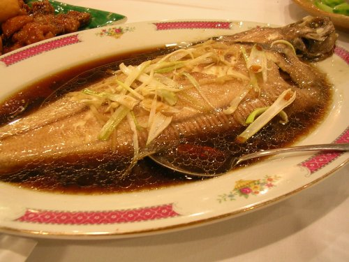 Steamed whole fish with soy ginger sauce