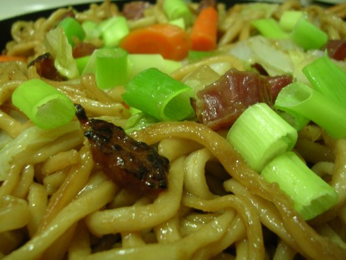 Stir fried fresh noodles with veggies and chinese sausage