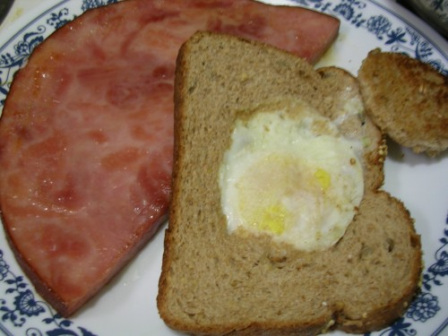ham steak and eggs in a basket