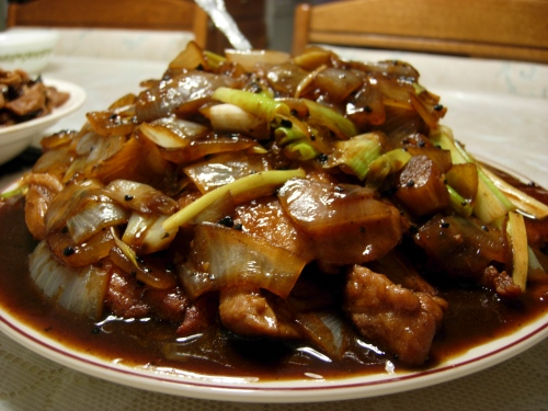 Sweet and sour pork chops with onions