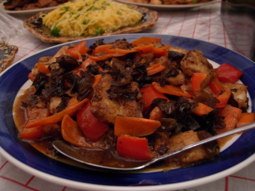 Battered fish filets with carrots, red peppers and wood ear fungus in sweet and sour sauce