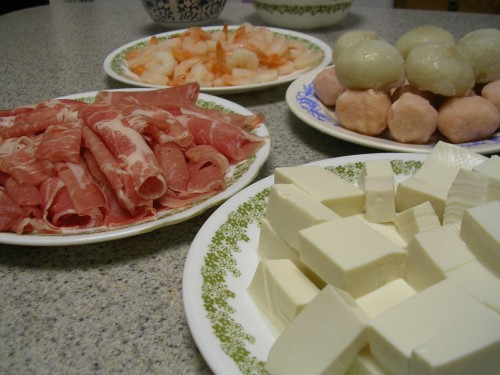 Sliced pork, cooked shrimp, shrimp and fish balls, and tofu