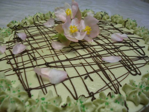 green tea cake decorated with pink flowers