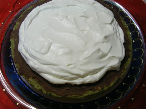 whipped cream spread on top of red bean paste layer