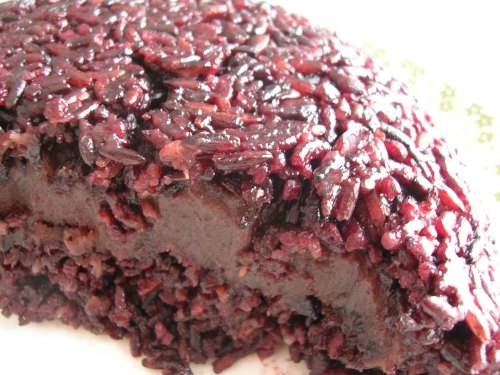 black sticky rice pudding with red bean paste