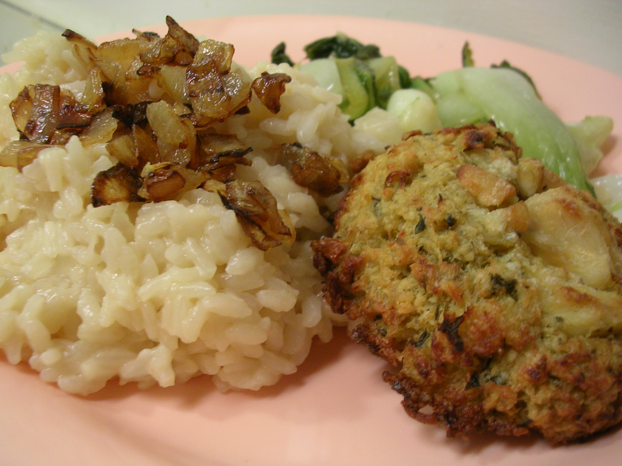 Basic risotto (topped with caramelized onions) and crab cake