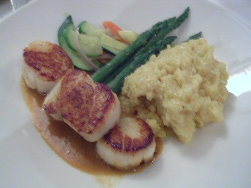 Seared jumbo sea scallops with saffron risotto and lobster sauce