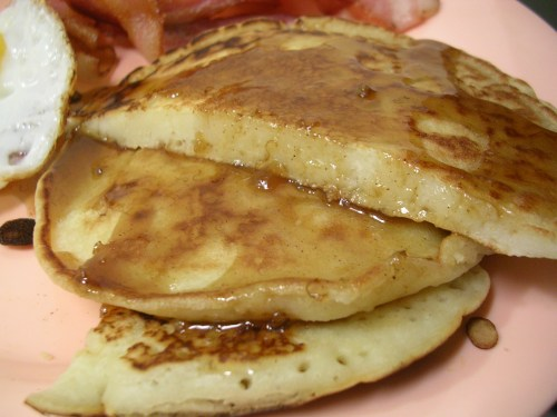 Coconut pancakes with bananas foster sauce
