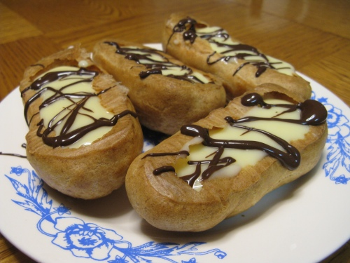 Upside down vanilla eclairs with chocolate drizzle