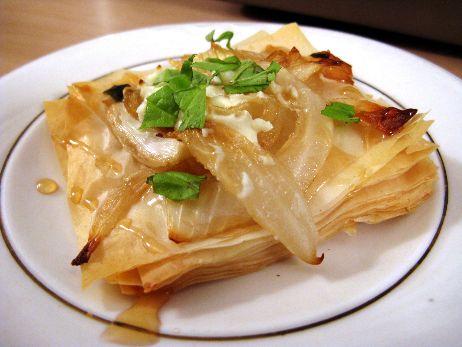 Caramelized onion and goat cheese phyllo tarts with fresh basil
